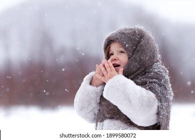 little girl looking the snowfalling