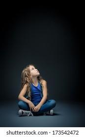 Little girl looking up in studio