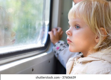 Little girl looking through  train