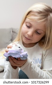 little girl looks at hamster, children and pets