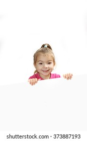 the little girl looks out because of a sheet of paper. isolate on a white background