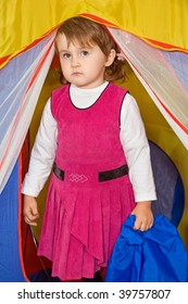 little girl looks out of tourist tent