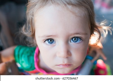 Little girl looks with sadness
