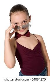 little girl looks through glasses.child on a white background.schoolgirl.child's interest