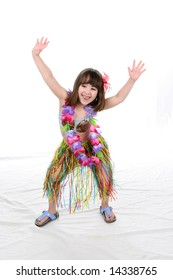 Little girl in Luau style outfit dancing the hula