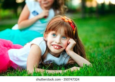 Little girl lying on the grass