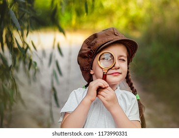 Little girl with magnifying. Little detective