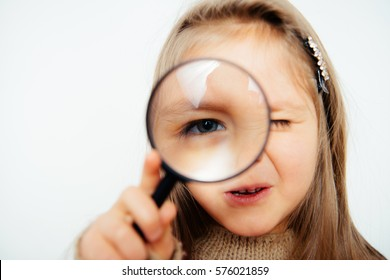 little girl with a magnifying glass