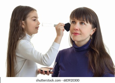 Little girl makes make-up to her mother