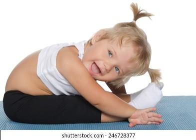 Little girl makes the slopes on blue mat
