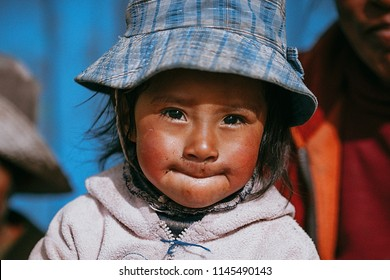 Little girl makes us grimace in front of the camera. January 2018. Cusco, Peru.