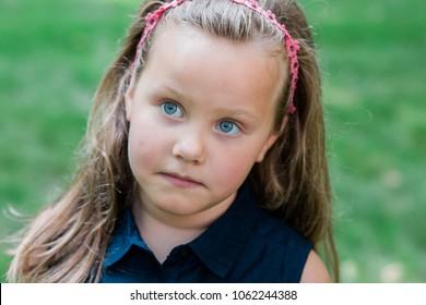 Little girl making faces outside