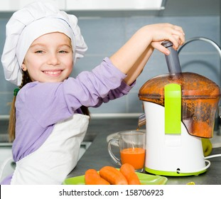 little girl making fresh carrot juice