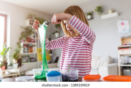 Little girl making homemade slime toy