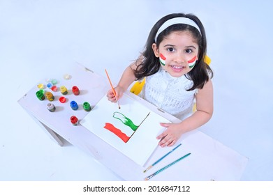 Little girl making Indian flag using poster colors on the occasion of Independence day India celebrations - Shutterstock ID 2016847112