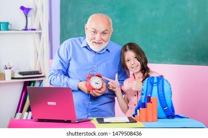 Little girl man tutor study. Back to school. Teacher help schoolgirl. Study online lesson. Pedagogue friendly kind. Punctual pedagogue. Study digital science. Time to study. Beginning of lesson.
