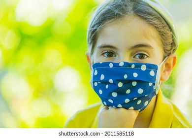 Little girl with mask against corona virus covid outdoor