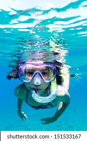 a little girl with mask exploring underwater in the Mediterranean Sea