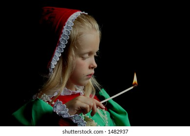 Little girl with match