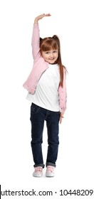 Little girl measuring height on white background