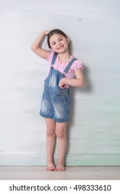 little girl measuring her height