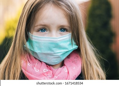 A little girl in a medical mask with sad eyes and hope. Coronavirus Covid-19 concept. Close-up