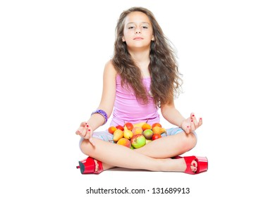 little girl meditates and healthy food isolated on white