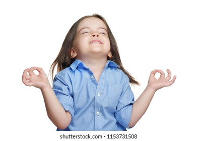 Little girl meditating with closed eyes against white background