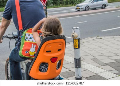 Little Girl With A Miffy Bag At The Backside Of Bicycle At Amsterdam The Netherlands 2018