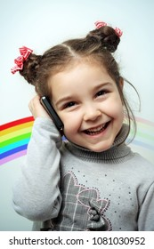 Little girl with mobile phone