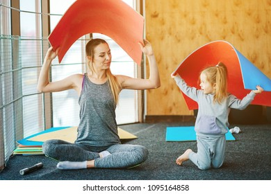little girl and mom having fun in the gym