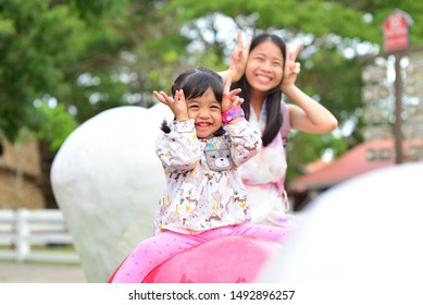 Little Girl and Mom Playing at Public Park