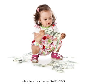 A little girl with money. Isolated on a white background