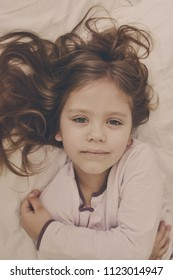 little girl in the morning  in her bed
