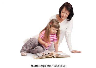 Little girl with mother looks family album isolated