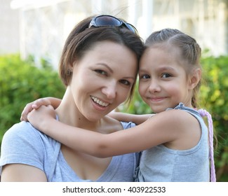 Little  girl with  mother in  park