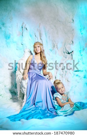 d9e0bec1b2266 Little girl with mother in princess dress on a background of a winter fairy  tale.