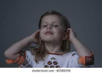 Little girl in national Ukrainian dress, embroidered shirt