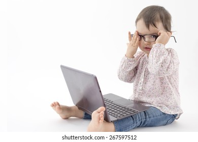 little girl with notebook and glasses