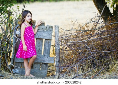 Little girl old wooden fence