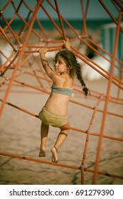 Little girl on the beach at the playground