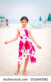 Little girl on the beach in summer day, Thai beach.