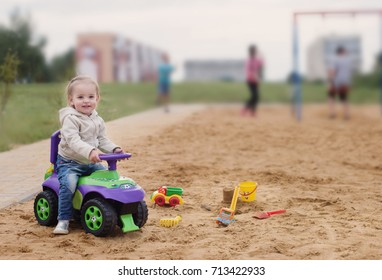 little girl on car