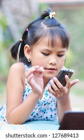 Little  girl on a cell phone
