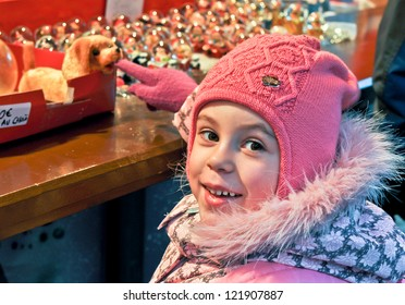 little girl on a Christmas market