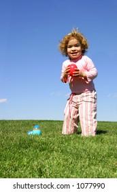 A little girl on an Easter Egg hunt.