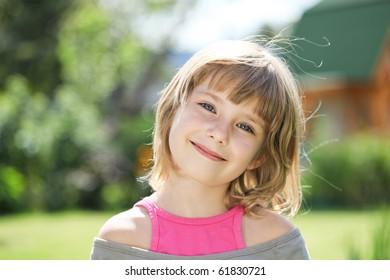 little girl on a greem background