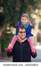 Little Girl on her Dad's Shoulders