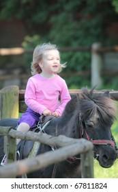 little girl on horseback