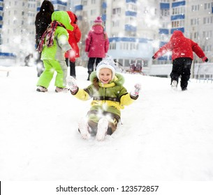 Little girl on the ice slide